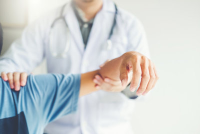 a person being checked for muscle pain