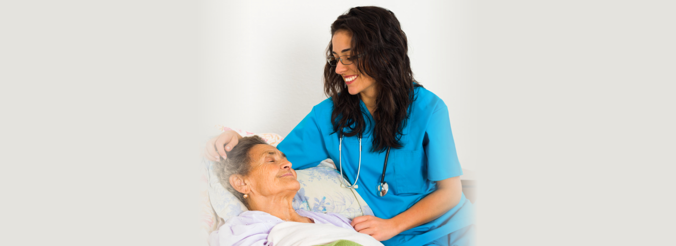 Kind nurse easing elderly lady s days in nursing home with care help and joy