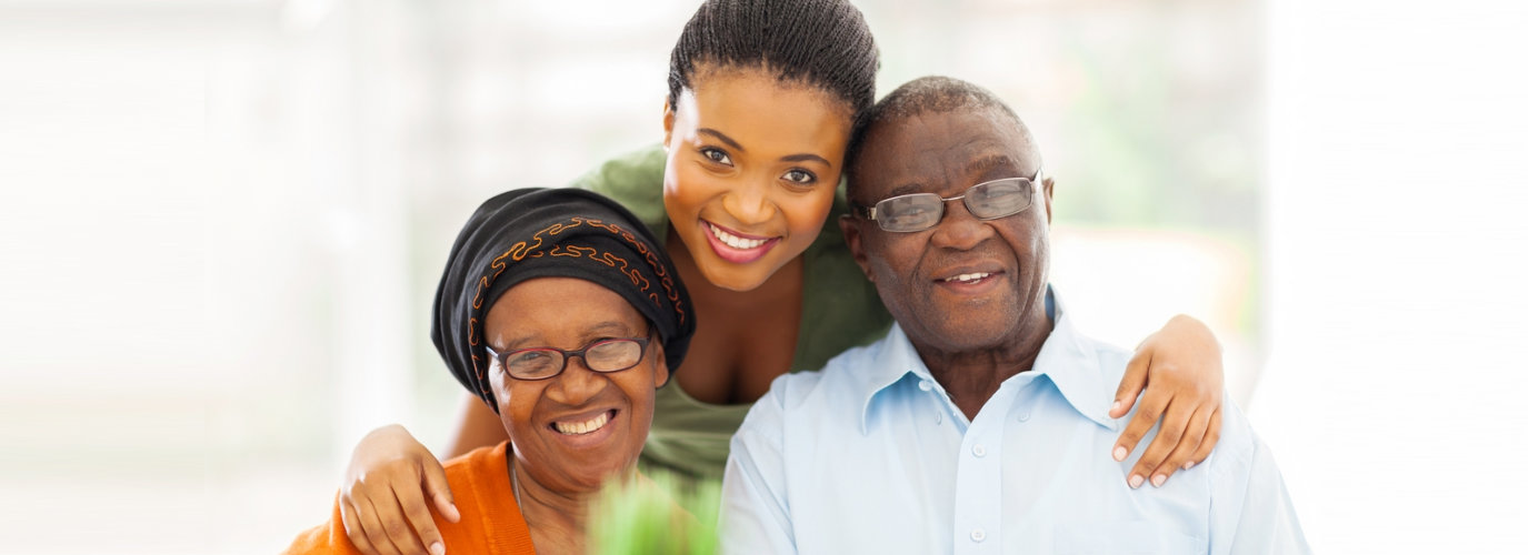 senior couple and caregiver smiling